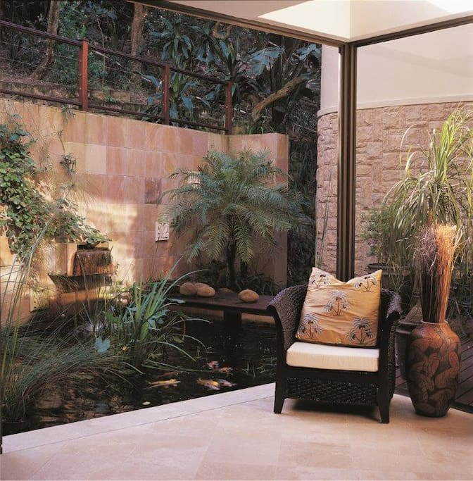 Koi pond area with opening sliding doors.