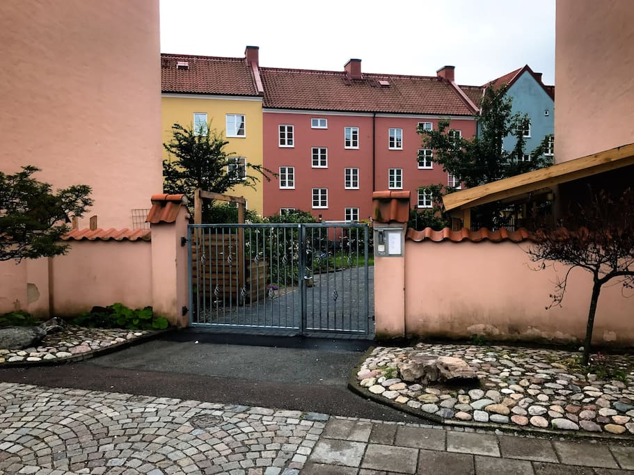 Main gate. I live in the left entrance at the pink house.