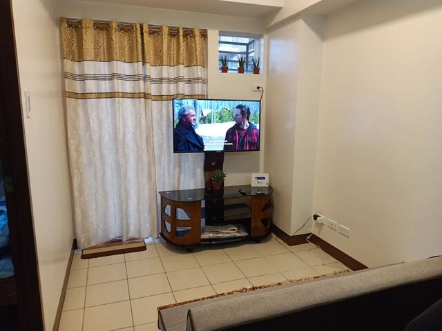 """The living area equipt with 43"""" Smart Tv with Netflix."""
