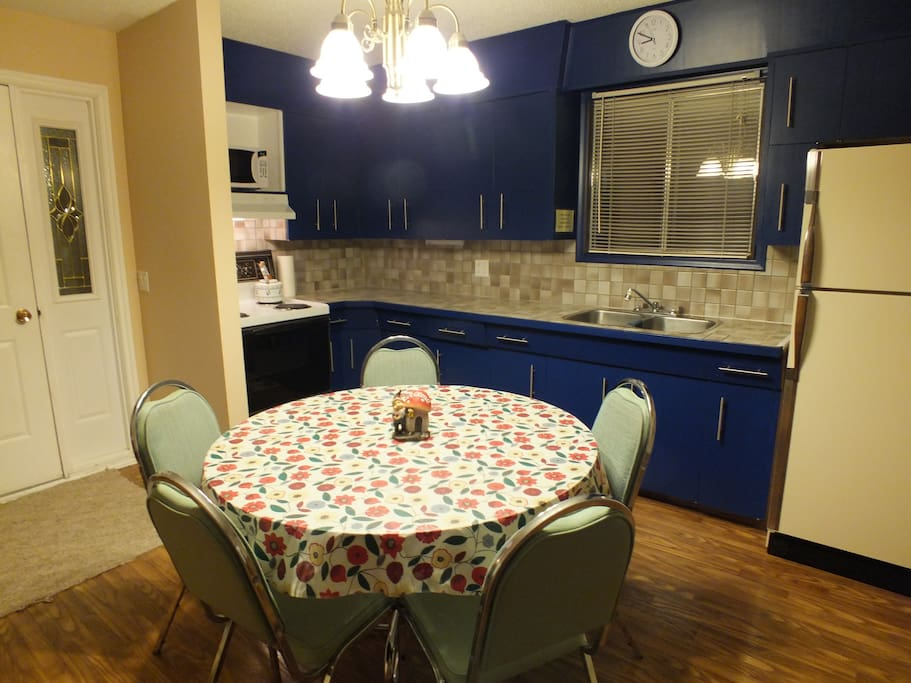 Round table accomodates many guests for meals or table games.