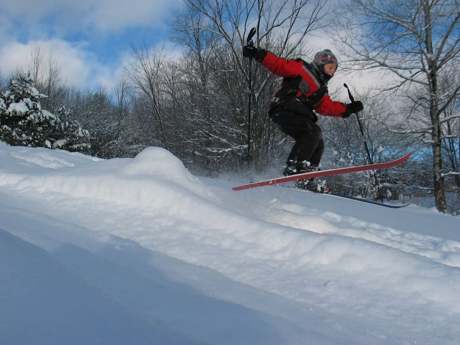 Jumping high on the sledding hill.