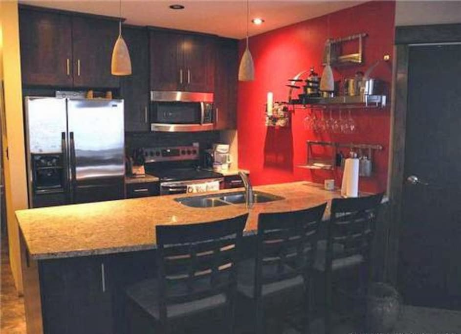 Fully stocked kitchen with modern appliances