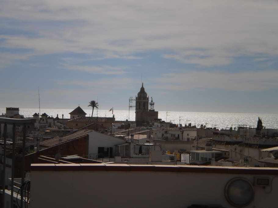 view of old town of Sitges and sea from long, back balcony