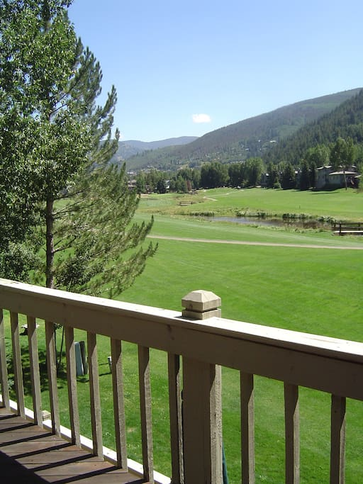 View from our deck of the golf course and the back side of Vail
