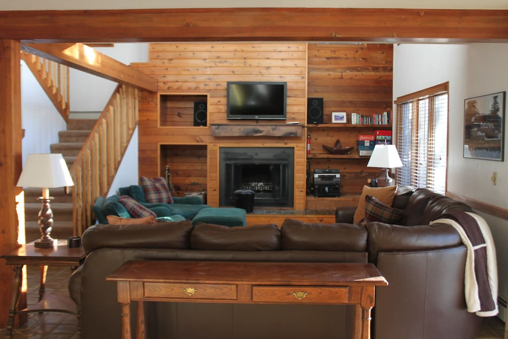 Large family room with seating for at least 10 comfortably, wood burning fireplace, cable television, music with iPod connection, and many board games for all ages