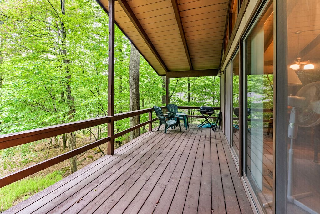 Step out onto the balcony where you can get a look at the lake through the trees.