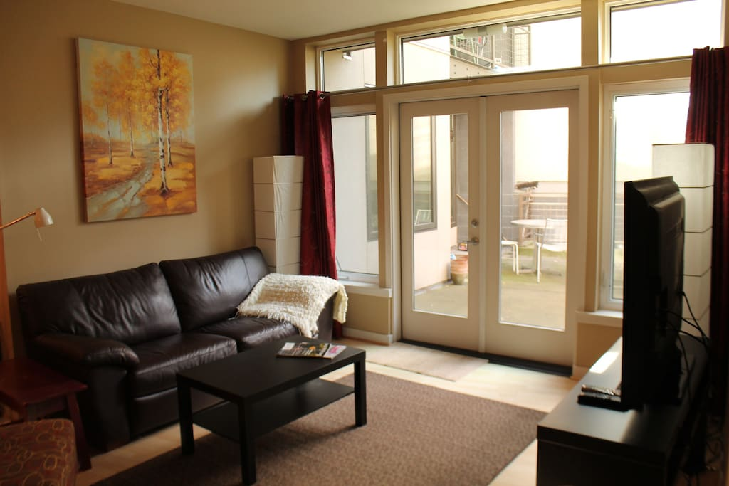 Light and airy living room space, french doors opening to patio