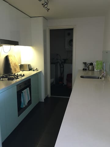 Fully equipped kitchen with dish washer and walk-in internal laundry with washer and dryer.