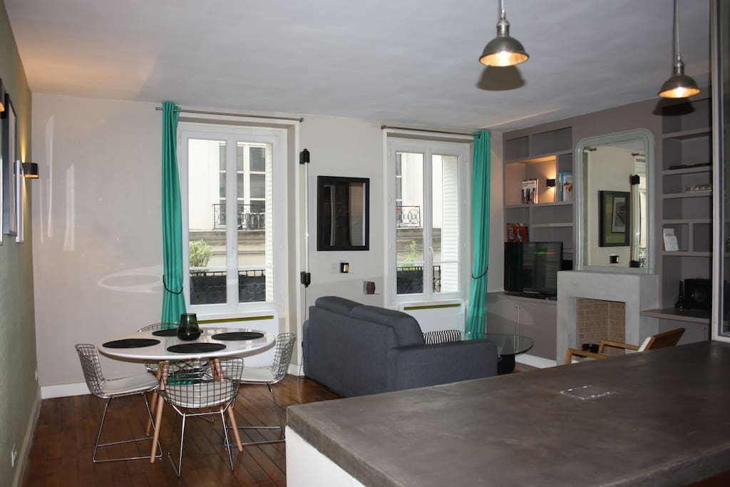 What I personnaly really like in my apartment is first : the area , 2nd the mix of material : wooden floor : warm and typically parisian  + concrete (kitchen bar + fire place)