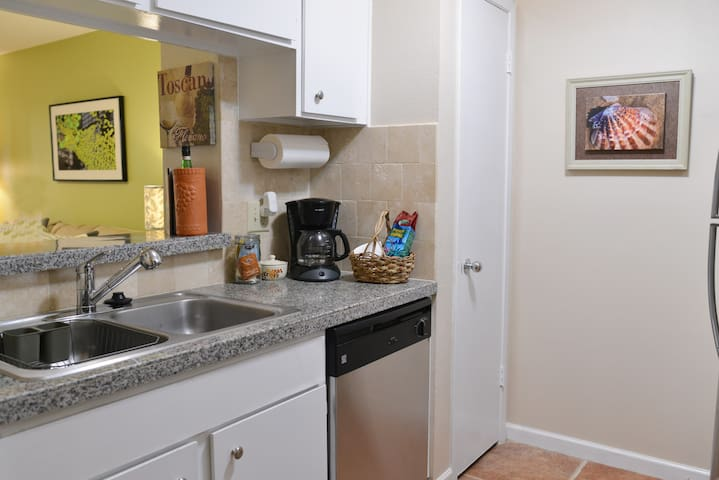 Kitchen with granite countertops, sink and dishwasher