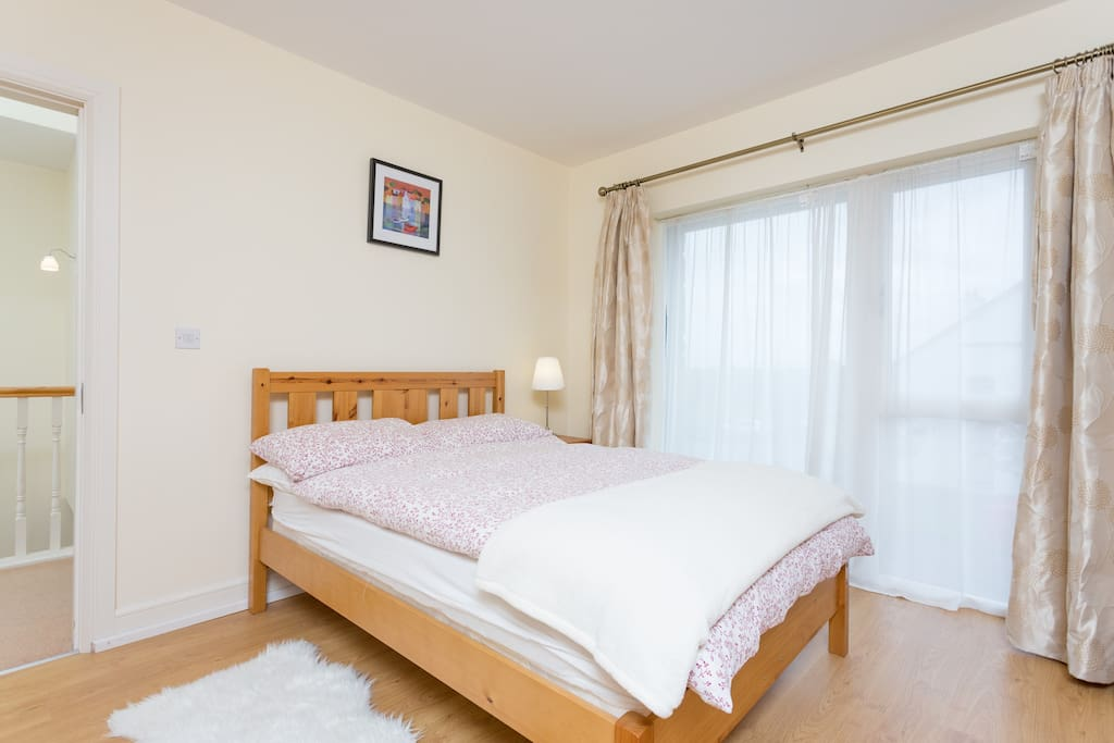 A comfortable double bed awaits  in this room for two