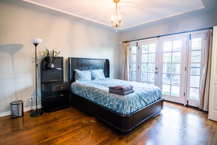 Bedroom 2: Queen Bed with ample natural light