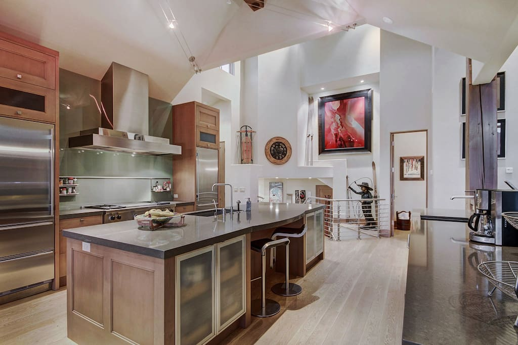 Great kitchen with two refridgerators , two ovens and large 6 burner stove.