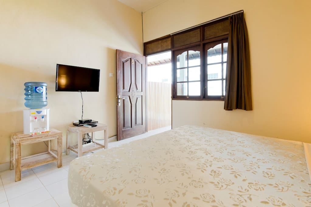 Swimming Pool, FREE Breakfast, Large Flatscreen Satellite TV, New Comfortable Queen Bed, Large Window, Bedside Tables, Rattan Lamps. Local Balinese Artwork. Daily Cleaning is included. Towels, Toilet Paper and Soap are also included.