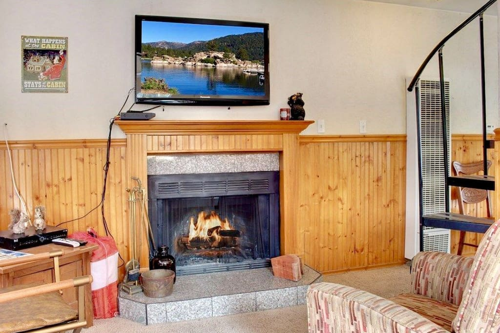 Cozy fireplace and flat screen TV on living room