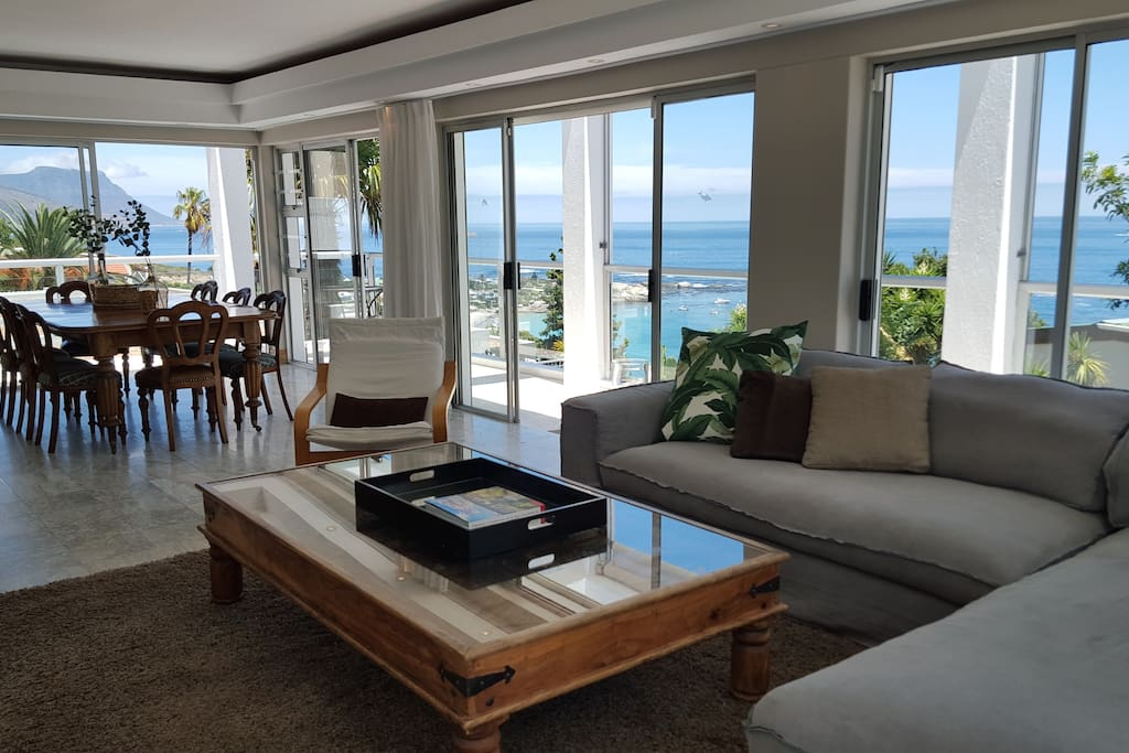Airy Lounge/Dining room area with Clifton First Beach below!