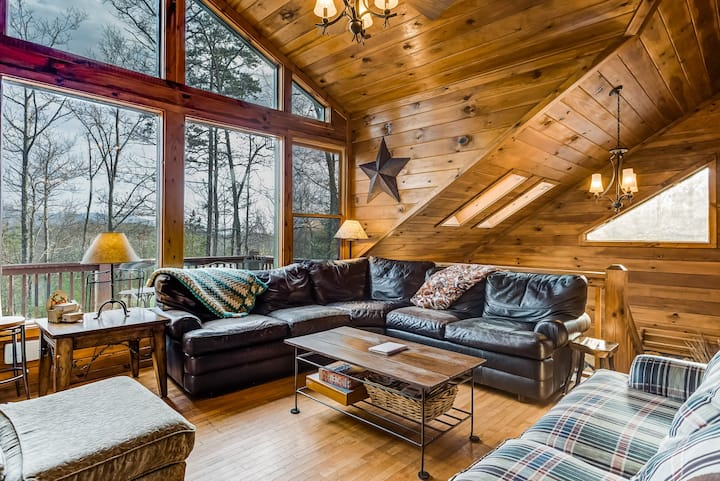 Dog-friendly cabin in the trees w/ private hot tub & furnished deck!