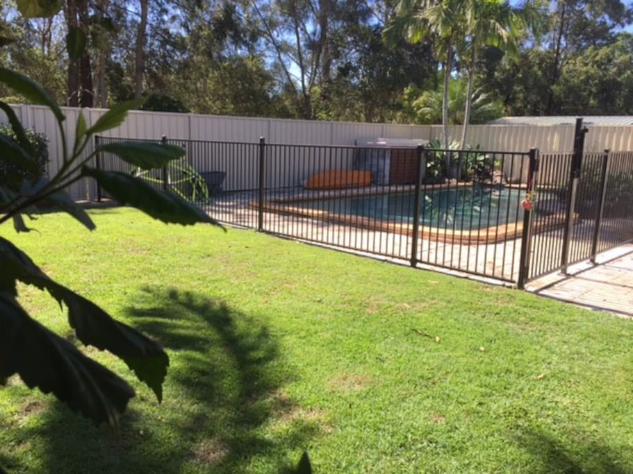 Back yard with separate fully enclosed pool