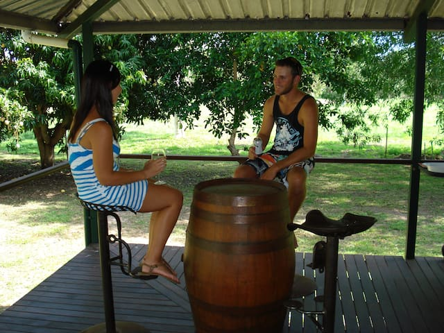 Relaxed setting with tractor seat chairs and wine barrel table