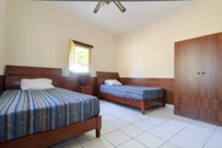 Room with two big comfortable single beds