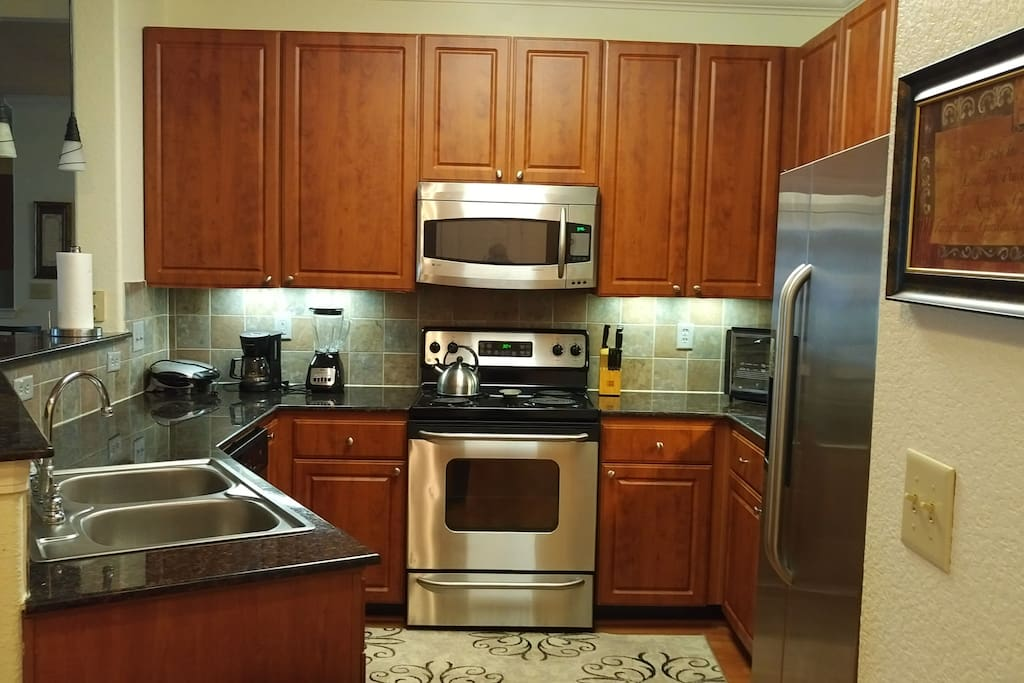 Spacious kitchen with plenty of cabinet space. Stainless steel appliances.