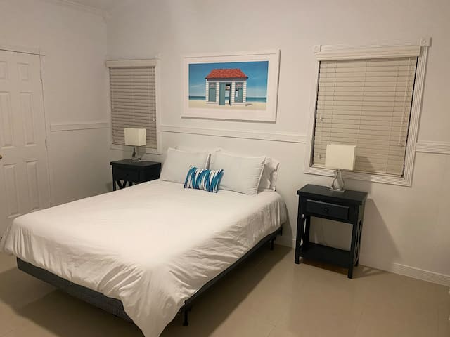 Spacious master bedroom with queen size bed and his and hers closet
