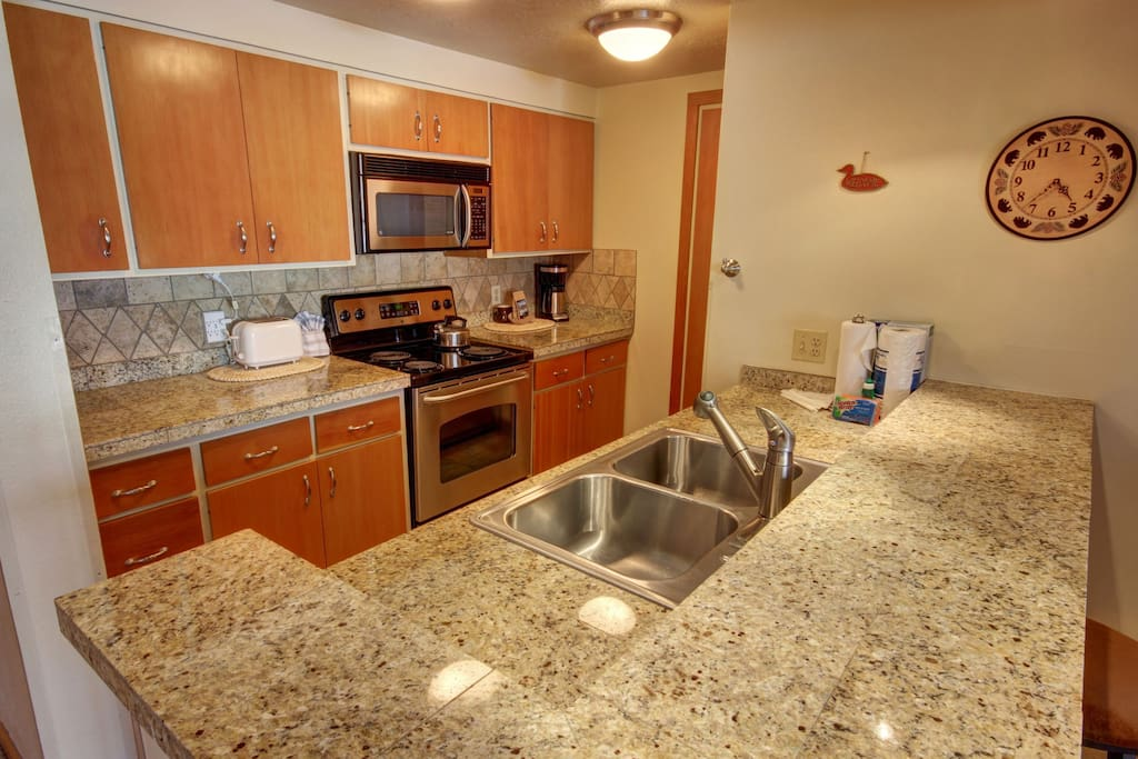 Updated counters & appliances in this roomy kitchen