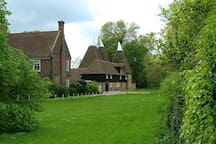 The Green in Littlebourne, with oasthouses