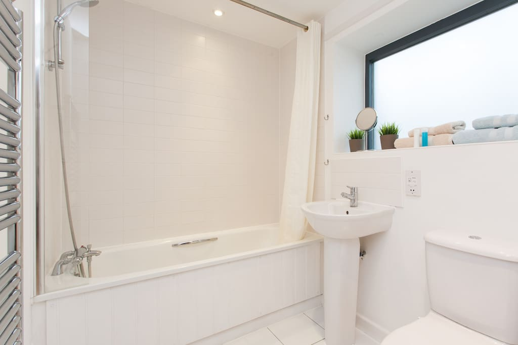 The Bathroom has ample space and a towel heating rail.