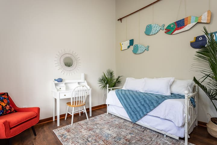 The Veracruz Room doubles as a quiet workspace or a second bedroom on the main floor (day bed + trundle bed).