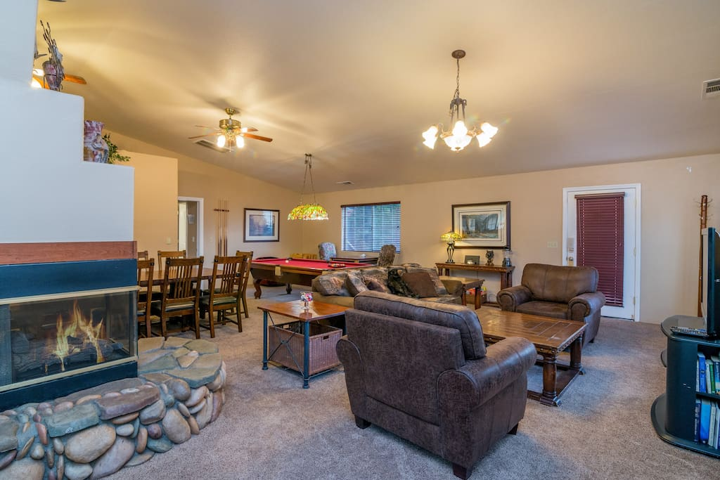Living room has a 3 sided gas fireplace and plenty of comfortable living space.