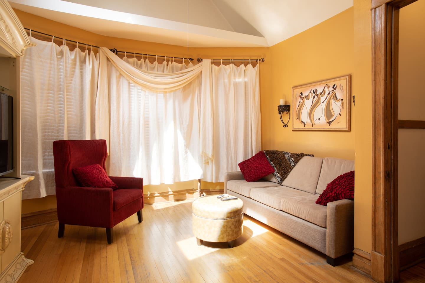 Comfortable and cozy living room for friends and family to gather. Natural light from the sun.