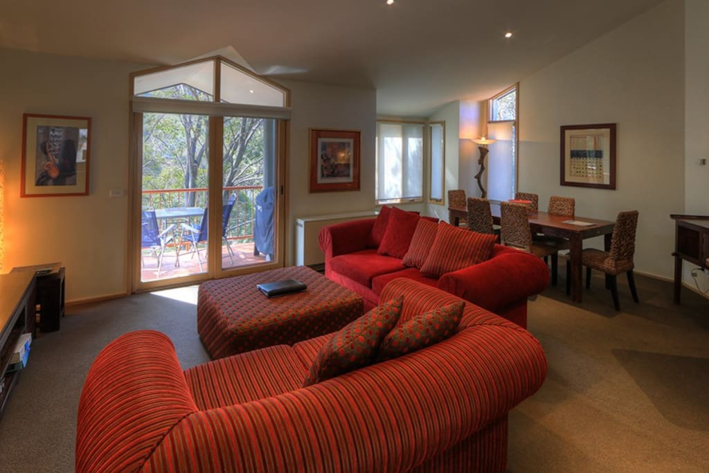 Comfortable spacious living room with wonderful leafy views.