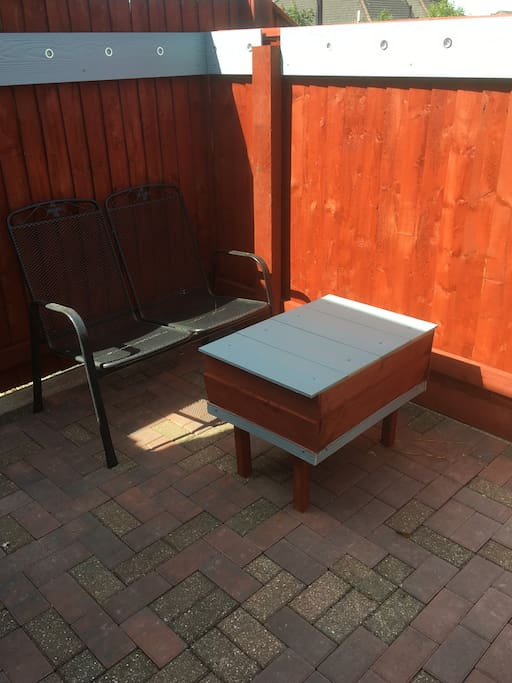 Small private gated sitting area with washing line