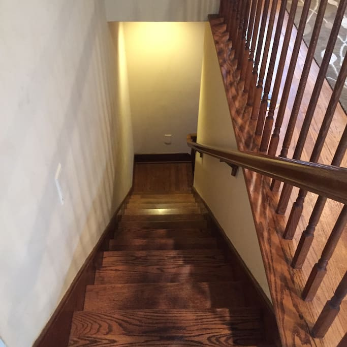 Private staircase leads to 2-room guest suite