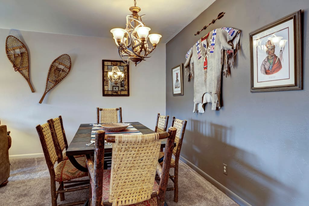 Dining area with Old Hickory log chairs & antler chandlier