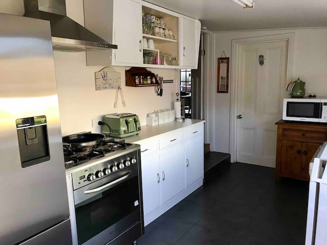 Kitchen boasts water dispensing refrigerator, ice making freezer, gas cook top with gas or electric oven, micro wave, dish washer, toaster and kettle. Everything you need to cook up a storm!