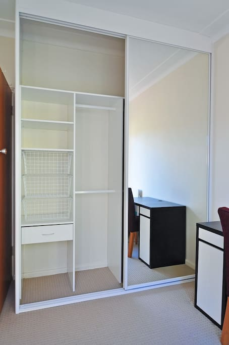 Large modern built in wardrobe with plenty of storage space