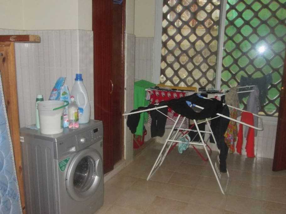 In house washing machine and laundry room.