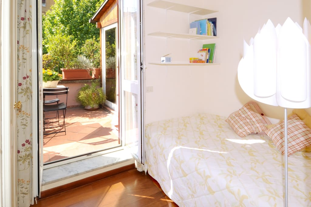 The small bedroom has a three-quarter bed and a large closet.