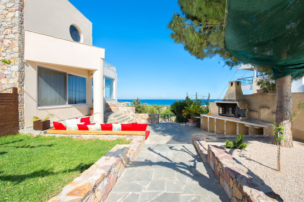 Your private garden with grass, big BBQ and sea view