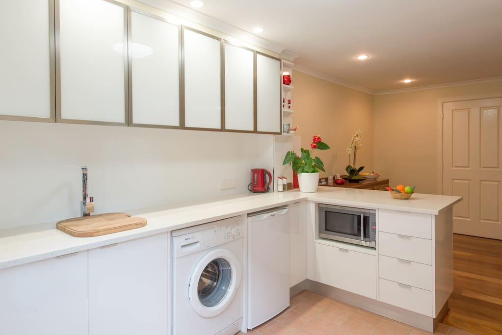 New kitchen with convection microwave, plug in hotplates and oven, slow cooker and use of Weber BBQ. Front loading washing machine and own outside clothes line, as well as inside clothes rack. Iron and small ironing board in unit. Drier available on request.
