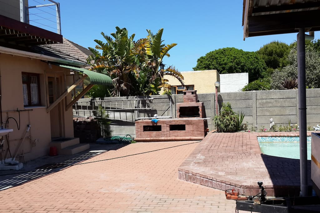 Backyard with Braai area and swimming pool on the right of picture