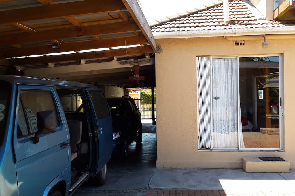 Back of house with downstairs access door, and to the left tandem garage for our cars plus one guest car