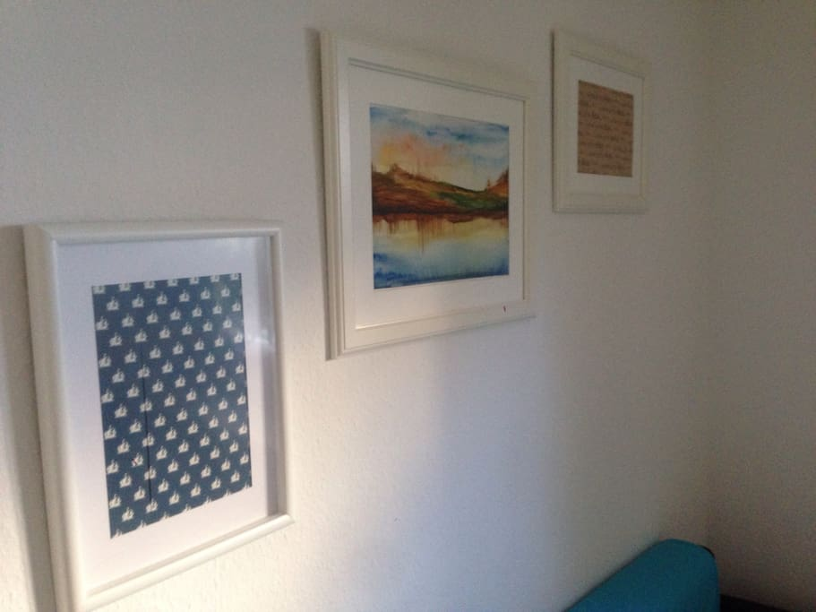 I plan to make a gallery wall over my sofa in the future and frame my other paintings instead of those patterns.