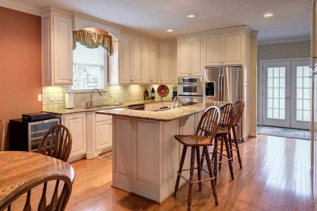 Kitchen with Oak dining table seating up to 8.