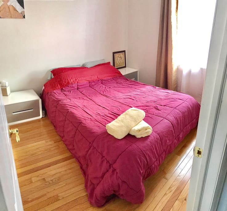 Front view of your bedroom (With fresh and clean sheets and towels)
