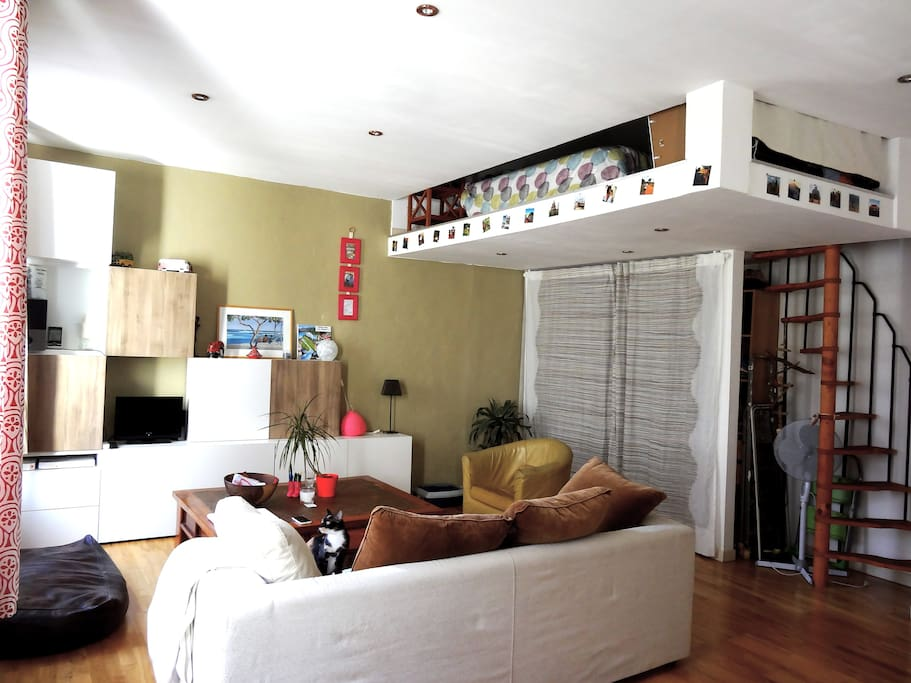 Living room : sofa bed, coffee table, TV, armchairs, closet, stairs up to your mezzanine !