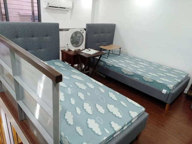 2 single beds with 2 cabinets on the loft area
