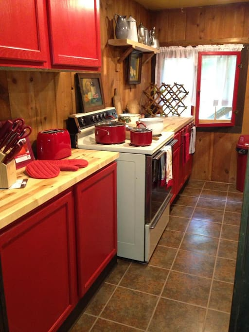 Kitchen is furnished with dishes/utensils including for grill, pots/pans, toaster, coffee pot, Brita water pitcher, kitchen towels/dish cloths, microwave